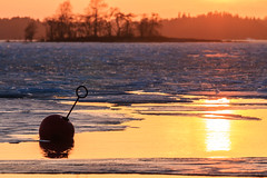 Winter is almost over (rlanvin) Tags: winter sunset sea lake ice water finland frozen helsinki buoy sigma70200f28