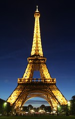 Tower of Light (PA Tanhuanco) Tags: camera light sunset paris france tower architecture night canon photography rebel steel eiffel dslr cityoflights 550d 18135mm t2i