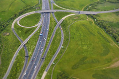20140526_F0001: That M25 junction to the airport (wfxue) Tags: road trees building london cars window sign truck plane circle airplane drive town miniature airport highway traffic motorway heathrow roundabout flight aerial lorry illusion sit faux intersection diorama m25 lanes tiltshift passengerplane passengerjet