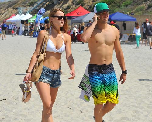 shirtless woman man cute couple sandals young casual handbag daisydukes fairgoers carlsbadbeachfest