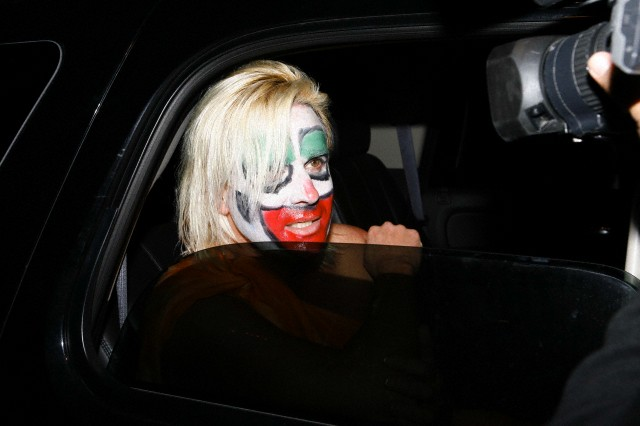 Daniel DiCriscio dressed as his former client Anna Nicole Smith is interviewed by Paparazzi on Halloween