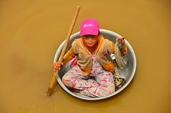 Dollar for Picture? (Pedestrian Photographer) Tags: brown lake water girl hat 1 village snake floating bowl pole pj pjs dollar stick python pajamas begging beg sap pajama tonle dsc1429 dsc1429jpg