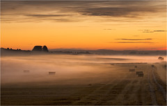 Beckhampton Twightlight Mists (Chris Beard - Images) Tags: uk mist misty sunrise landscape dawn farmland september fields wiltshire strawbales mists beckhampton