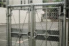 (pop archaeologist) Tags: city nyc newyork film brooklyn gate kodak parkslope chainlinkfence basketballcourt retinaiia uncoatedlens highschoolparkinglot