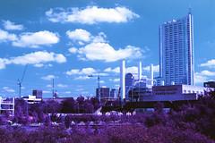 Austin Skyline (BlazerMan) Tags: film 35mm nikon purple f100 powerplant xr austintx 100400 lomagraphy cityofaustin afnikkor50mm118d lomochrome