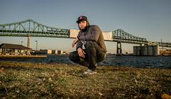 Mr Hamlet (maximus_leonte) Tags: street bridge portrait water grass boston hoodie fujifilm chucks strobe urb fitted x100 strobist monolights bostonstrong