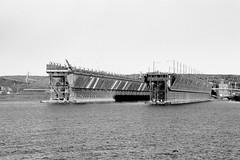 Ore docks at Two Harbors (rexp2) Tags: industry steel greatlakes lakesuperior nikonf3 oredock fujifilmneopanacros100 bwblackandwhitebw nikkor4386mmf35zoom kodakhc110developerdilutionb filterdeepyellowwratten15 vacation2013fall