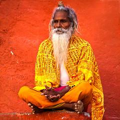 Sitting Sadhu (Dick Verton ( more than 6 million views! )) Tags: travel red people orange india asia sitting sit barefoot varanasi meditation seated sadhu dickverton vision:text=051 vision:outdoor=0819