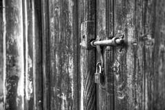 Character BW (heshaaam) Tags: door bw contrast bahrain lock muharraq