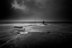 Israel (Hemo Kerem) Tags: longexposure seascape beach water silhouette clouds israel blackwhite fisherman sony lowkey tokina1116mmf28 sonya77 mygearandme mygearandmepremium mygearandmebronze mygearandmesilver mygearandmegold blinkagain