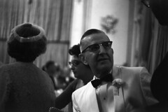083659 21 (ndpa / s. lundeen, archivist) Tags: people blackandwhite bw woman man flower film monochrome 35mm glasses blackwhite women nick bowtie august tuxedo ballroom 1950s eyeglasses corsage weddingreception 1959 unidentified formalattire dewolf whitetuxedo nickdewolf photographbynickdewolf locationunidentified