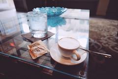 @Artisian's Table (ahh.photo) Tags: water coffee table milk cafe orlando italian downtown florida fujifilm espresso macchiato froth packets canesugar sugarintheraw turbinado xt1 xf14mmf28r artisianstable