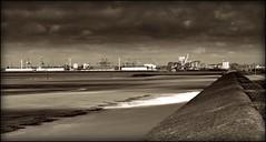 New Brighton (Missy Jussy) Tags: light sea england sky bw seascape monochrome sepia clouds docks canon landscape mono blackwhite sand shadows northwest horizon lancashire walkways walls newbrighton cannon600d