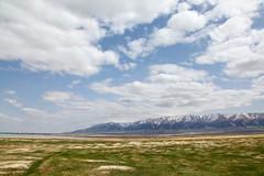 Tian Shan moutains and grassland in Barkol (inchiki tour) Tags: travel sky mountains clouds photo uighur xinjiang silkroad  uyghur grassland  kazakh worldheritage  tianshan       kumul  qumul   barkol   komul  tengritagh  barkl