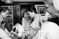 Mom catching baby (shutterdoula) Tags: birth doula midwife hospitalbirth birthphotography