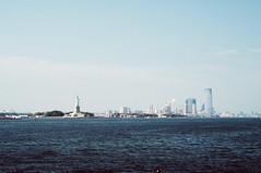 New York City ( Nino) Tags: new york city nyc blue sky film apple ferry skyline brooklyn clouds analog skyscraper 35mm island 50mm boat big downtown fuji state 10 manhattan grain wide sigma scratches burn empire pro fade mm analogue 20 50 1020mm 35 provia flares staten ferryboat 400h