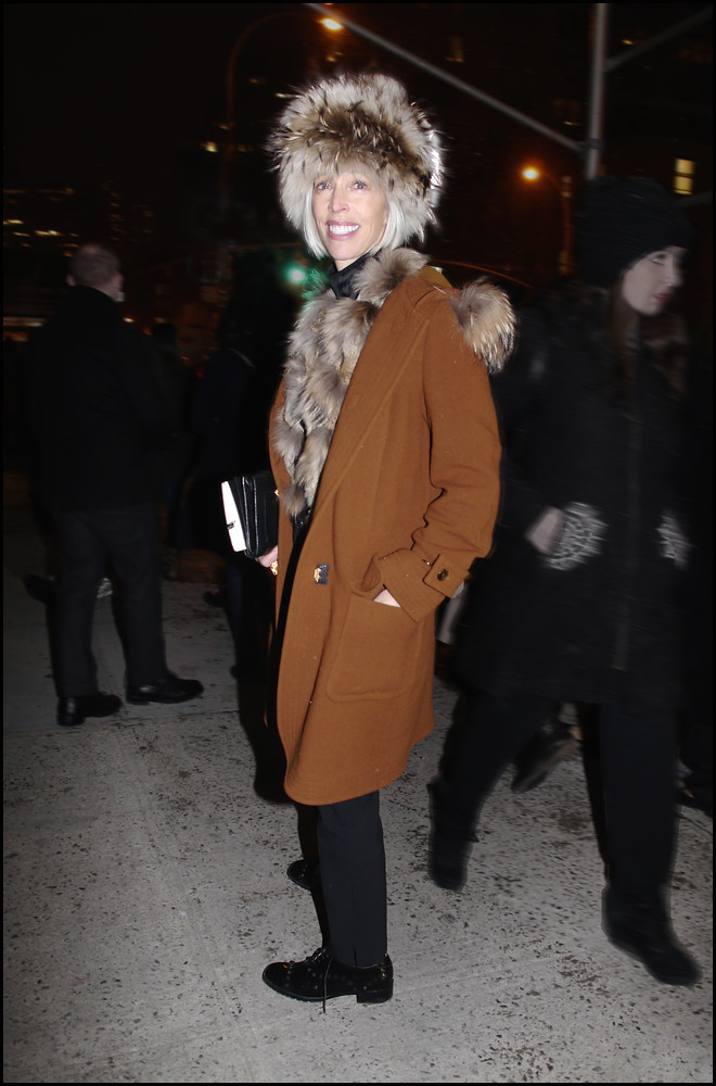 FW 2014-2 -24 w linda fargo 2-2014 fur hat and scarf burnt orange coat black pants after DVF ol