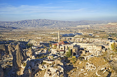 View of ancient Nevsehir cave town and a castle of Uchisar dug from a mountains in Cappadocia, Central Anatolia,Turkey (marozn) Tags: area background cappadocia caves church field goreme heritage history kapadokia landscape mountain nature old outdoors people region rural scenery stone town travel turkey valley view mountains beautiful panorama panoramic roof france aerial ancient architecture building burgundy city cityscape detail famous houses landmark tower cloudy clouds nevsehir uchisar hill castle hotel