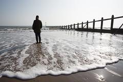 On the beach 49/365 (rmrayner) Tags: dawlishwarren beach groyne wavebreak sand sea sootc seaside water waves figure standing devon coast 49365 365daysof2017 365project 365the2017edition