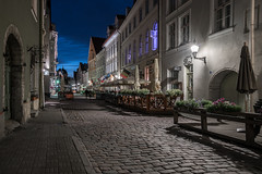 Walking back in time (McQuaide Photography) Tags: tallinn estonia europe northerneurope sony a7rii ilce7rm2 alpha mirrorless 1635mm sonyzeiss zeiss variotessar fullframe mcquaidephotography adobe photoshop lightroom tripod manfrotto light bluehour dusk twilight outdoor outside building city longexposure capitalcity street illuminated wideangle old oldstreet oldtown cobbled cobbles pedestrian atmosphere charm lowlight streetlight pavement sidewalk architecture timeless cobblestone medieval historic history terrace vene