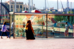 When the sun plays with a glass ..................... (donatadag) Tags: barcelona street city light people art glass colors canon reflections photo spain women europe catalogna