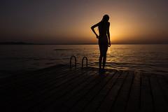 Shielding the Sun (V Photography and Art) Tags: sunset sea summer sky seascape silhouette seaside jetty croatia ripples zadar adriatic