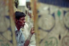 A Breath of Refreshment (Sheikh Shahriar Ahmed) Tags: street portrait film analog 50mm nikon candid streetlife fujifilm dhaka bangladesh banasree candidportrait nikonf6 f6 af50mmf18d fujicolorc200 dhakadivision epsonv330 sheikhshahriarahmed
