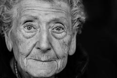 Two sweet eyes out from the dark (Giulio Magnifico) Tags: portrait dark eyes sweet streetphotography streetportrait soul elder udine nikond800 nikkormicro105mmafsvrf28