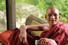 Monk with a cell phone (KX Studio) Tags: travel canon burma cellphone monk myanmar mandalay saffron earthasia rebelt3i