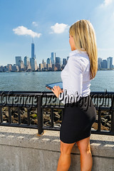 Back View of a Woman in Black Skirt and White Blouse Standing and Holding a Tablet Computer, Jersey City,New Jersey (George Oze) Tags: newyorkcity morning woman usa sexy vertical standing river outdoors happy newjersey model jerseycity slim riverside manhattan unitedstatesofamerica working relaxing scenic drinking lifestyle skirt trendy blonde attractive northamerica commuter manhattanskyline hudsonriver handrail highkey hip relaxation sideview tablet information youngwoman enjoyment beautifulpeople fit confident slender backview caucasian shapely whiteshirt hudsoncounty ipad toothysmile blackskirt shoulderlengthhair drinkingcoffee lookingforward onewomanonly whiteblouse pencilskirt caucasianethnicity modelphotography 34length caucasianwoman fairskinned focusonforeground tonedbody tabletcomputer professionalwoman professionallook modernlook 3035yearsold mid30yearsold holdingpapercup readingfromtablet usingtabletcomputer