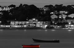 poole11 (simoncoram) Tags: light sea blackandwhite white black beach water night clouds boats lights boat seaside harbour dorset nightsky sandbanks poole ilumination iluminated lightstraeks