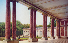 1944 color postcard of the peristyle of the Grand Trianon which was built in the northwestern part of the Palace of Versailles at the request of King Louis XIV (thstrand) Tags: park france color building history tourism museum architecture facade buildings french outside outdoors photography europe european exterior architecturaldetail 17thcentury columns nobody courtyard halftone souvenir versailles pillars picturesque royalty monarchy grandtrianon colonnade portico ionic palaceofversailles keepsake peristyle 1600s photopostcard kinglouisxiv historicsite aristocracy aristocratic yvelines historicsites chateaudeversailles traveldestinations historicphotos chteaudeversailles rgionparisienne historicalphotograph traveldestination builtstructure 1680s ancienrgime builtstructures maitresseentitre ancientregime ledefranceregion columnedporch marquisedemontespan matresseentitre opencolonnade