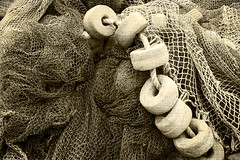 fishing net with corks and vintage effect (Mimadeo) Tags: sea blackandwhite white fish black detail texture net thread closeup sepia port vintage outdoors cord grid harbor fishing marine mess mesh background cork fishnet rope knot retro equipment filter catch float effect nylon corks buoy fishingnet