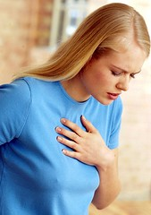 Panic disorder linked to increased risk of heart attack, heart disease (sdavusahn) Tags: woman home pain holding heart chest ill panic inside clutch hold illness anxious caucasian asthma indigestion clutching chestpain asthmatic 2035 asthmaattack panicattack chestpains