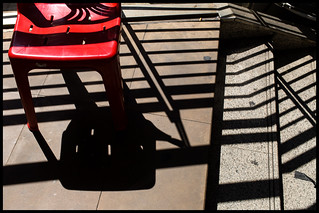 Red Chair & Black Shadows