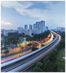 Ang Mo Kio (190317) (n._y_c) Tags: architecture mz714f28pro m43 microfourthird buildings mrt angmokio publichousing city cityscape lighttrails livecomposite sunset cloudsstormssunsetssunrises car singapore leefilters