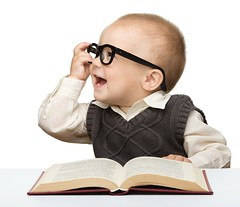 Speed Reading Course in India (rasleenkaur1) Tags: childhood person beautiful single adorable student read toddler bite joy cutout playful glasses closeup learn casual one cheerful horizontal infant caucasian beauty sit sweet intelligent white kid education book innocence little holding child portrait people smile baby small table isolated cute play young knowledge fun boy happy male human ukraine