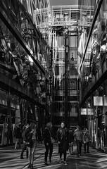 St. Pauls In The Sun (devil=inside) Tags: monochrome handphotography sony a77 bw london capital street st pauls one new change shops reflections glass steel elevators lifts people