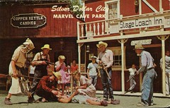 Comic Drama In Silver Dollar City, Marvel Cave Park, Branson MO (SwellMap) Tags: vintage advertising death pc fight 60s gun dummies fifties postcard kitsch retro nostalgia crime chrome western murder violence duel amusementpark americana shooting deathvalley 50s tacky roadside dummy themepark sixties frontier gunfight shootout midcentury oldwest frontiertown effigies waxmueum