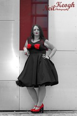 IMG_4504 (Neil Canon Keogh) Tags: red black vintage necklace highheels dress retro ring redhead bow buskers bracelet heels rockband pinup pinupgirl trianglesquare manchestercitycenter dressmodellaura