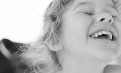 A piece of happiness (Cilou101) Tags: portrait blackandwhite smile child noiretblanc portraiture laugh enfant sourire rire cilou101