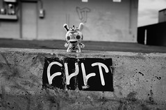 Cult (Dorian's_Portrait) Tags: street arizona urban white black art toys graffiti sticker vinyl kidrobot cult dunny handstyle maxx242
