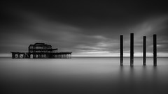 IIII (vulture labs) Tags: uk longexposure light sea england sky urban blackandwhite bw white seascape black west building art abandoned water monochrome architecture clouds dark photography mono coast pier photo nikon brighton exposure industrial day mood angle pano horizon fineart fine wide smooth monotone monochromatic panoramic structure photograph crop format daytime straight 169 iconic silky ratio lightroom slowshutterspeed