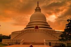 At the God's feet (magicallights) Tags: peacepagada japanesepeacepagoda ceylon srilanka unawatuna blessed bless buddha buddhatemples buddhisim goldensun goldenhour