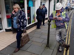 taking a break (watcher330) Tags: carmarthen worker overalls phone woman