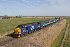 37423 approaches Stracey Arms working 2P21 1317 Great Yarmouth - Norwich 13/3/2017 (Paul-Green) Tags: class 37 374 37425 37423 aga abellio greater anglia passenger service drs direct rail services canon 7d mk2 mark ii uk gb railways station platforms flickr outdoor march 2017 sun sunny afternoon stock engine lchs norfolk norwich gt great yarmouth 1317 2p21 stracey arms a47 acle straight road windmill countryside fields background tracks englshelectrictype3three diesel loco traction locomotive