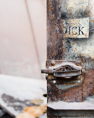 """Dick"" (D A Baker) Tags: dick notsausage paint door rust vacant abandoned derelict demolish rundown urban exploring urbex fort ft wayne indiana latch steel metal sand grit dust nikon d610 screw bolt"