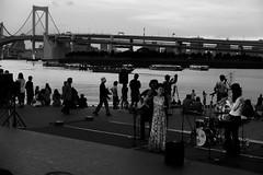 Odaiba, Tokyo (jae-hoon) Tags: bridge people bw white black japan night tokyo rainbow mood singer odaiba persons