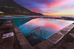 Coalcliff Sunrise (stevoarnold) Tags: pink blue sunset mountain pool clouds swim sunrise pacific sydney australia nsw newsouthwales eastcoast oceanpool coalcliff