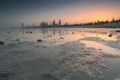 Sunrise over Kuwait City! (AlkhashabNawaf) Tags: pink orange seascape beach colors yellow sunrise buildings landscape cityscape fuji lee fujifilm kuwait filters q8 nawaf     xe1   alkhashab